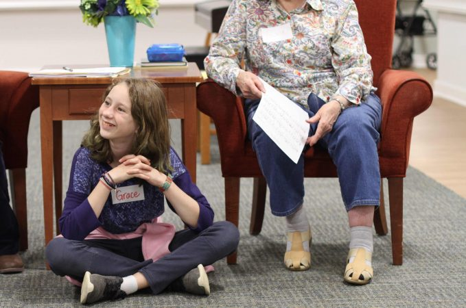 Fifth grader Grace Fairfield listens attentively to a resident and new friend at Virginia Mennonite Retirement Community.